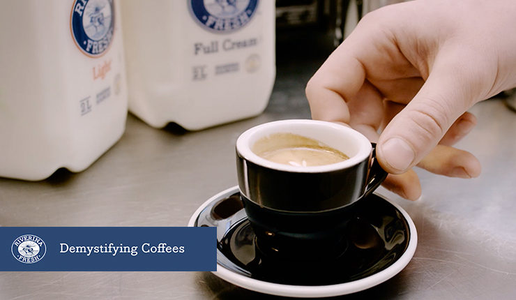 """Small cup of coffee made with text """"demystifying coffee"""""""