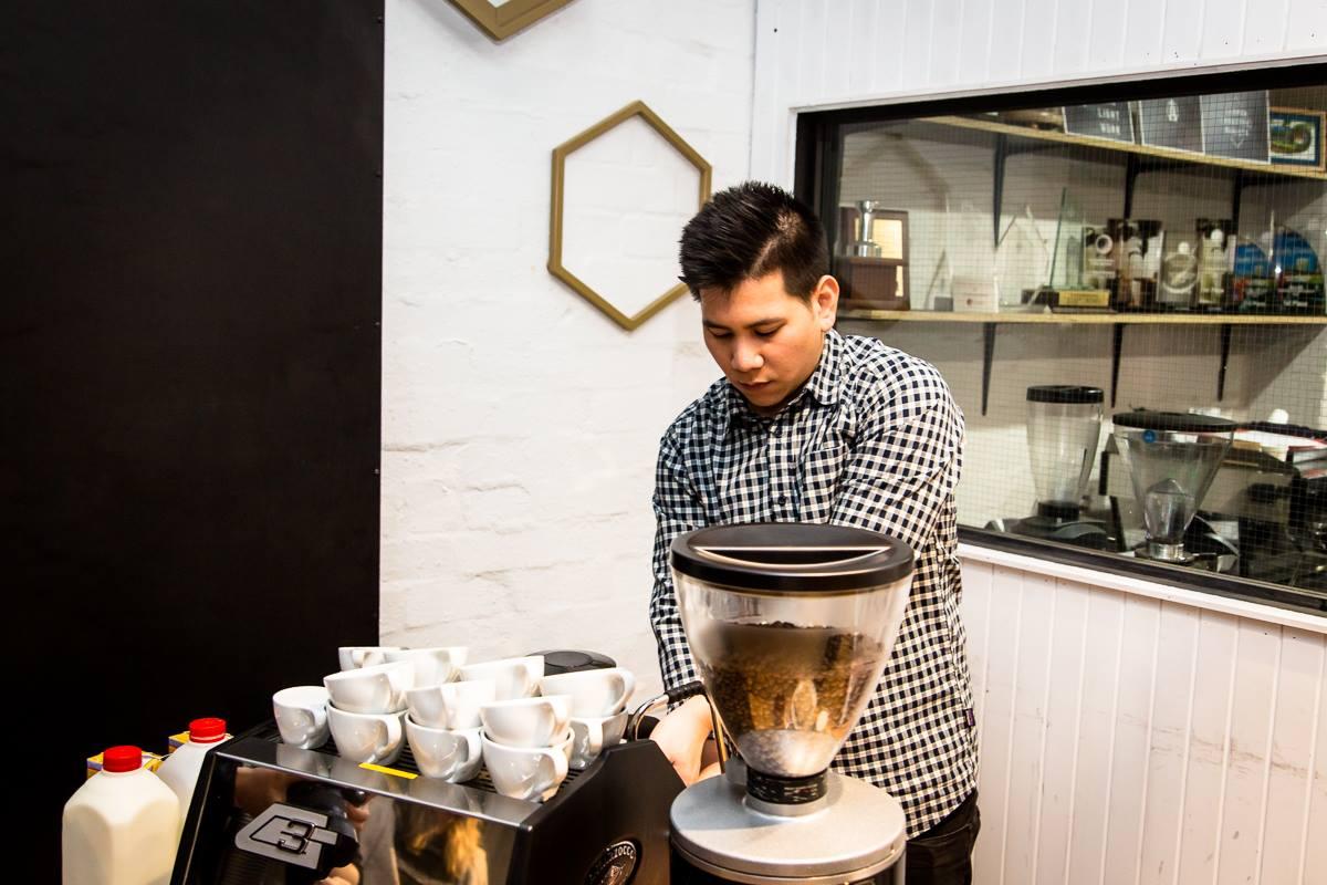 Man standing behind coffee machine